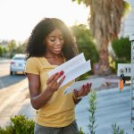 african american woman checking mail in las vegas community