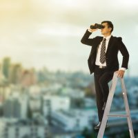 Business vision looking forword with binoculars